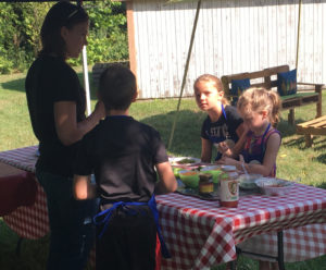 Instructor Emily Adams talks with kids during the Fourth annual Local Foods Kids Cooking Camp at Local Bounty Coshocton on Tuesday, Aug. 9.  Andrew Everhart | Beacon