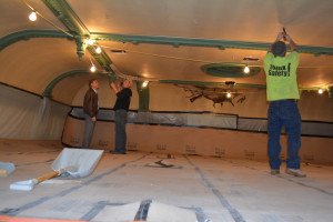 Jim Lepi, Mark Sheets and Jason Ethell, all of Lepi Enterprises, Inc. are pictured doing work on the ceiling of the Common Pleas Court Room in the Coshocton County Courthouse. Beacon photo by Josie Sellers