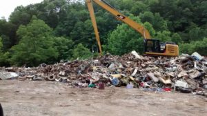 This is one of the scenes Cindy Gray saw while delivering supplies to flood victims in West Virginia. This pile of debris was flooded onto the highways and had to be pushed off it and loaded onto dump trucks. Contributed | Beacon