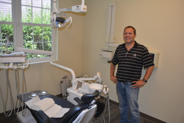 Dr. Todd Salmans will be moving his practice to a new building on Monday, Aug. 31. He is pictured here in one of the new patient rooms. Salmans is expanding from four to six patient rooms in his new facility.