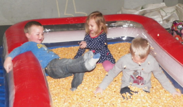 A group of excited children enjoy the corn pit at the Coshocton County Farm Bureau Extravaganza on Feb. 26. Jen Jones   Beacon