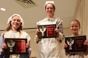 Winners: Pictured from left are: Sophie Meiser, 12-13 age group winner; Maddy Meiser, 14-15 age group winner; and Caroline Pinson, 10-11 age group winner. Photo contributed to The Beacon