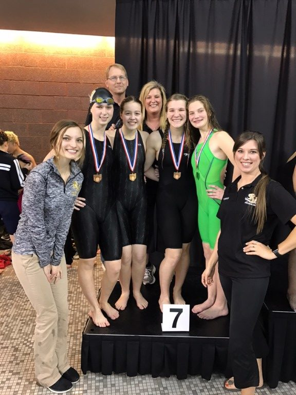 girls 200 relay with coaches