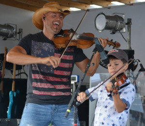 Chris Higbee performed a fun and energetic show that also had some sweet moments like this one when he and his son played the fiddle together for the first time ever on stage. Josie Sellers | Beacon
