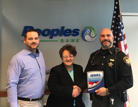 Pictured from left are Phil Hunt (Peoples Bank), Dee Stocker (Peoples Bank) and Lt. Dean Hettinger (Hometown Heroes Award winner). Contributed | Beacon