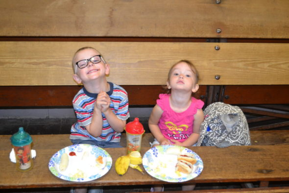 Caden and Kensie Renner enjoy their hot dogs, bananas and popcorn at the Hopewell Industries carnival at the Salvation Army on July 13. Both children won several prizes, including their favorites - candy and a slinky. Jen Jones | Beacon