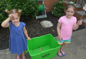 Emma and Ellis Hunt proudly show off two of the cicadas they have collected and enjoy playing with. The 3 and 5 year olds are the daughters of Phil and Krista Hunt. Josie Sellers | Beacon