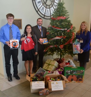 Donations: The Coshocton County Leadership and youth leadership classes came together for their December challenge day to experience a poverty simulation. Participants in the Coshocton Foundation programs also donated toys and food that will be distributed to families struggling financially this holiday season. Pictured are David Edmunds and Anna Egbert, from youth leadership and Matt Drummond and Stephanie Hawkins from the adult leadership class. Beacon photo by Josie Sellers