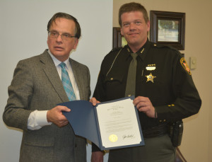 Commendation: Pictured from left are Bob Kalish, regional liaison for Secretary of State Jon Husted and Deputy Scott Mast. Kalish was in town March 24 to present Mast with a commendation for being named the Coshocton County Sheriff's Office Deputy of the Year. Beacon photo by Josie Sellers