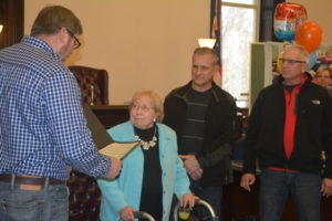 The Coshocton County Commissioners honored Clerk of Courts Janet Mosier for her years of service to Coshocton during her retirement party on Dec. 29 at the Coshocton County Courthouse. Pictured are Commissioner Curtis Lee, who read the proclamation to Mosier, and at her right are Commissioners Gary Fischer and Dane Shryock. Josie Sellers   Beacon