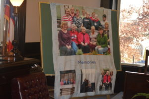 Clerk of Courts Janet Mosier received a special blanket as her retirement gift that featured pictures of current and past employees. Josie Sellers | Beacon