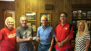 The Indian Mud Run was able to raise $10,000 for the Coshocton County Park Board. Pictured from left are: Lori Everhart, park director; Hubie Cushman, IMR Committee; David Erwin, park board chairman; Roger Moore, park board; and Kathy Milligan, park board. Contributed | Beacon