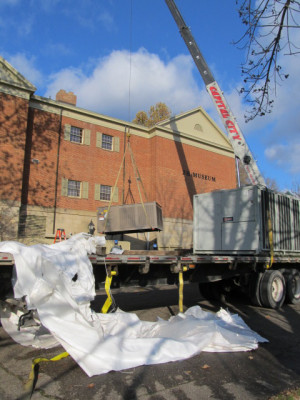 Project: Pictured is a crane moving in the new air conditioning chiller at the Johnson- Humrickhouse Museum. Photo contributed to The Beacon