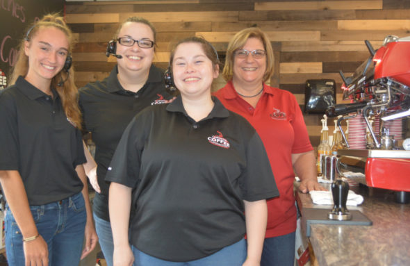 Coshocton Coffee Connection at 750 S. Second St. recently opened to the public. Pictured from left are three of the coffee shop's employees Cassidi Bookless, Heather Adkins and Dianna Rivera with manager Donna LaFollette. Josie Sellers | Beacon