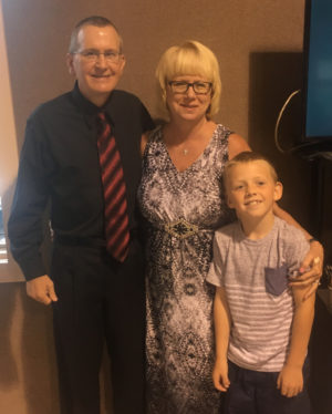 Pastor Chris Cutshall stands with his wife and son after being honored for his 30th year at Fresno Bible Church on Sunday, Aug. 14. Andrew Everhart | Beacon