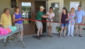 Ryan and Camille McPeek along with family members cut the ribbon to officially open the new M Event Centre at their Colonial Campground & RV Park. The ribbon cutting took place at an open house for the community on July 10. Josie Sellers | Beacon