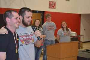 """Happy birthday: Pictured at far left with the Hopewell Indians coaches is Austin Saylor. The basketball team's banquet happened to fall on Saylor's birthday so the coaches got everyone to join together and sing him, """"Happy Birthday."""" Beacon photo by Josie Sellers"""