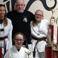 Martial arts students come home with trophies